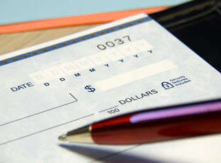 What are the effects of material alteration of cheque